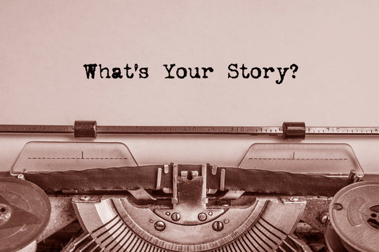 what's your story printed on a sheet of paper on a vintage printing machine. literature.