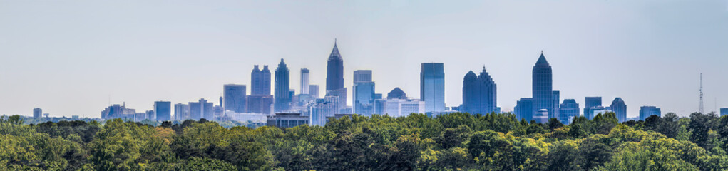 Downtown Atlanta Skyline showing several prominent buildings and hotels under a blue sky as seen from Buckhead in North Atlanta Fotomurales