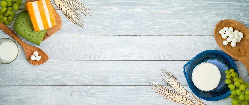 Milk and dairy products on wooden background.