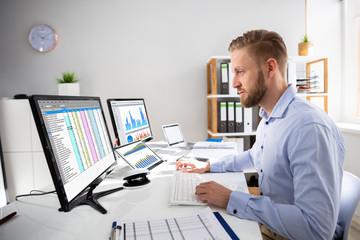 Businessperson Calculating E-Invoice