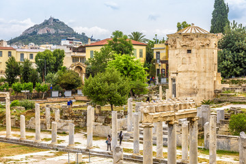 Fototapete - Roman Agora with Tower of Winds or Aerides, Athens, Greece. This place is a landmark of Athens. Panorama of Ancient Greek ruins in Athens center at Plaka district. Scenic remains of antique Athens.