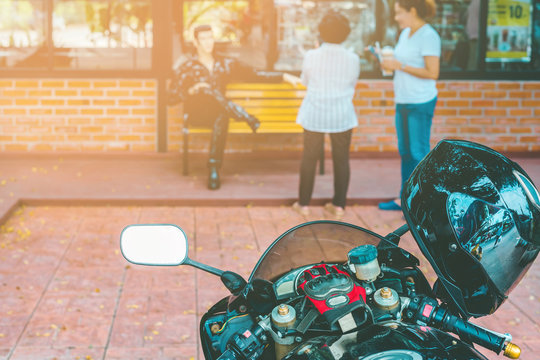 A sporty motorcycle parked in front of a coffee shop