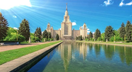 Reflections of main building of famous Russian university in fou