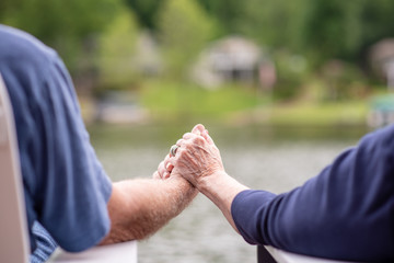 A senior couple holding hands while on vacation. Beautiful couple in their seventies celebrating a long, happy marriage.