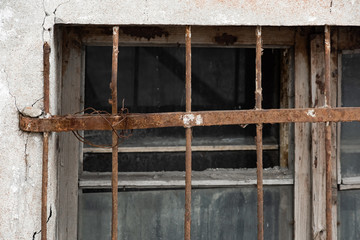 Printed roller blinds Old abandoned buildings Broken glass in a window with a rusty lattice