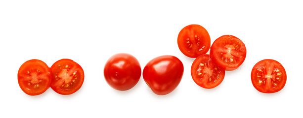 whole and sliced cherry tomatoes isolated on white background