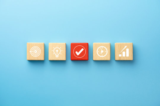Business plan concept with wooden blocks with icon business strategy on blue background