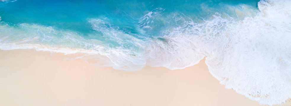 Top view panorama from aerial. Bali drone shoot with ocean waves.