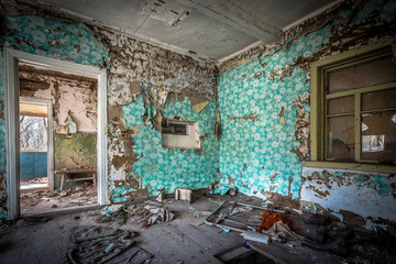Interior of  an abandoned little house in Belarus Chernobyl exclusion zone, recently opened for the public from april 2019.
