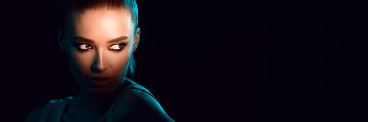 Fototapeta Play Of Lights. Woman in shadow over dark background