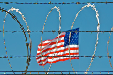 Fence, Razor Wire, Electrified Barbed Wire and the American Flag
