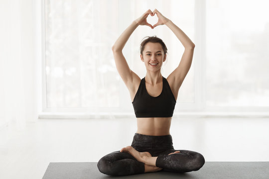 Love Yoga. Woman In Lotus Position Over Window
