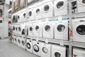 Close up blurred concept of DIY shopping center megamall with Appliances. Goods for home. Merchandising. Commercial LED lighting.