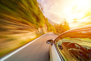 Car in motion blur driving in the Italian mountains Wall mural