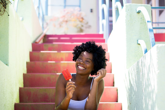 Woman Smiling Eating a Popsicle