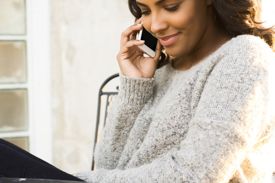 Woman Smiling On The Phone