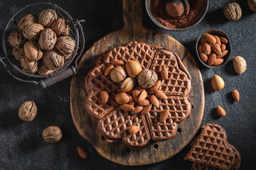 Homemade waffles made of cocoa with nuts
