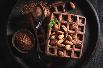 Delicious waffles with dark chocolate and nuts