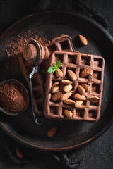 Tasty waffles with dark chocolate and almonds
