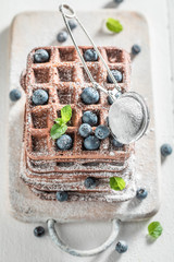 Tasty waffles made of cocoa with berry fruits