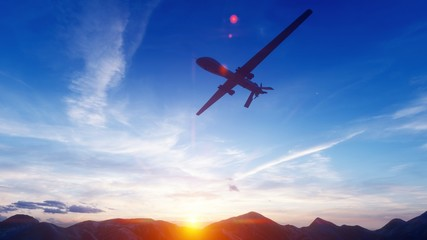 A military drone flies over a desert mountain plain at sunset. 3D Rendering Wall mural