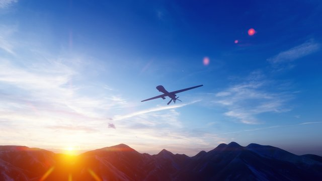 A military drone flies over a desert mountain plain at sunset. 3D Rendering