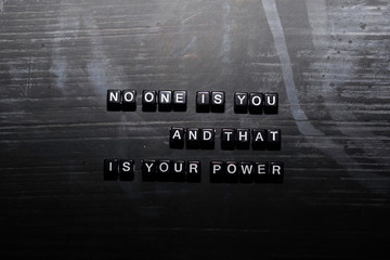 Photo sur Aluminium Positive Typography No one is you, and that is your power on wooden blocks. Education, Motivation and inspiration concept