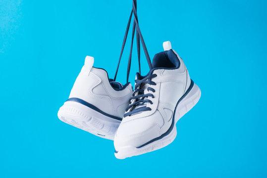 Fashion male sport shoes on a blue background. Stylish man sneakers for fitness, close up