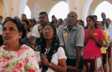 Devotees pray during a mass at the St.Theresa's church as the Catholic churches in Sri Lanka restart their Sunday service after Easter Sunday bombing attacks on 21st of April,in Colombo