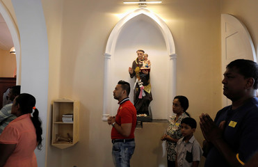 Worshoppers pray during a mass at the St.Theresa's church as the Catholic churches in Sri Lanka restart their Sunday service after Easter Sunday bombing attacks on 21st of April,in Colombo