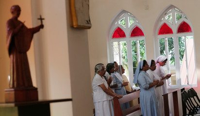 Nuns pray during a mass at the St.Theresa's church as the Catholic churches in Sri Lanka restart their Sunday service after Easter Sunday bombing attacks on 21st of April,in Colombo