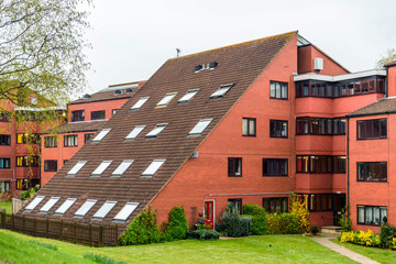 45 degree angle wall of red brick apartments building in england uk
