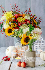 Fototapete - Bouquet of sunflowers and hypericum berries, candles, lace.