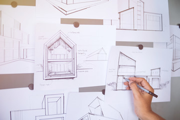 Architect Designer Engineer sketching drawing draft working Perspective Sketch  design house construction Project