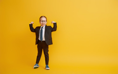 Kid on background of yellow wall