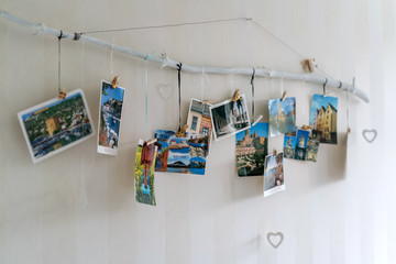 Lahti, Finland, Circa March 2019: collection of postcards from around the world hangs on the wall in the room, close-up, selective focus