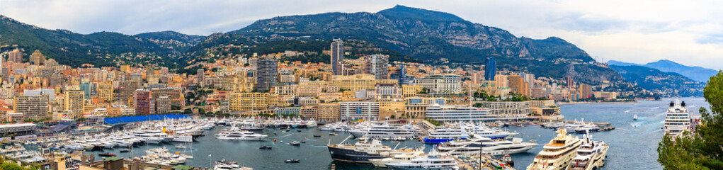 Monte Carlo panorama with luxury yachts and grand stands by the in harbor for Grand Prix F1 race in Monaco, Cote d'Azur