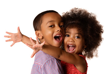 Two cheerful african-american siblings, sister hugging her brother, isolated