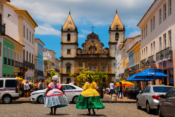 Bright view of Pelourinho in Salvador, Brazil, dominated by the large colonial Cruzeiro de Sao Francisco Christian stone cross in the Pra a Anchieta
