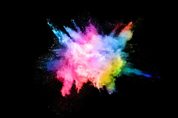 abstract colored dust explosion on a black background.abstract powder splatted background,Freeze...