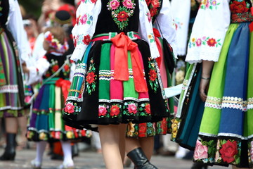 Fototapeta Women, girls and kids in traditional folk costumes from Lowicz region in Poland walk during annual Corpus Christi procession obraz
