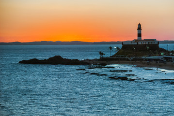 SALVADOR, BRAZIL: Portrait of the Farol da Barra Salvador Brazil lighthouse. Beautiful landscape with verm at sunset.