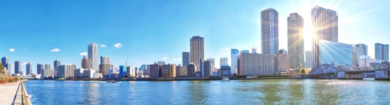 Panoramic view of winter Sumida river under blue sky in Tokyo wi