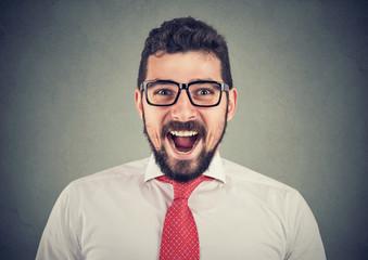 portrait of super excited surprised business man