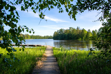 Summer view to the river Mustio and wooden walkway from the Mustion Linna park, Finland Wall mural