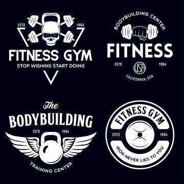 Set of monochrome fitness emblems, labels, badges and designed elements. Vintage bodybuilding logo templates.