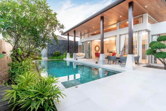 home or house Exterior design showing tropical pool villa with greenery garden,