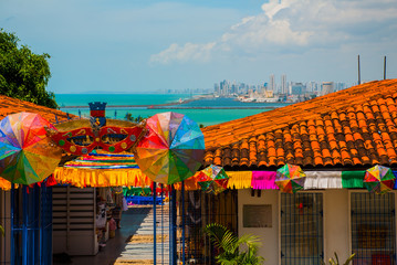 Olinda, Brazil: A view of the Handicraft's Market in Olinda's historic center, cityscape of Recife in the background