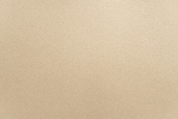 Abstract beige glossy paper texture background or backdrop. Empty light brown cardboard or shiny...