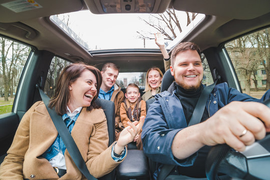 friends in car with little kid. car travel concept